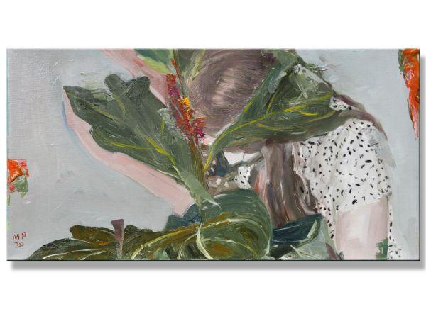 Frau mit einer Pflanze